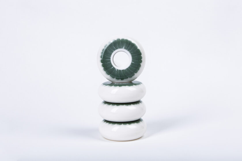 White Polyurethane 64 mm Wheels with Tinted Green Flower and Grey Linocut Outlines Design